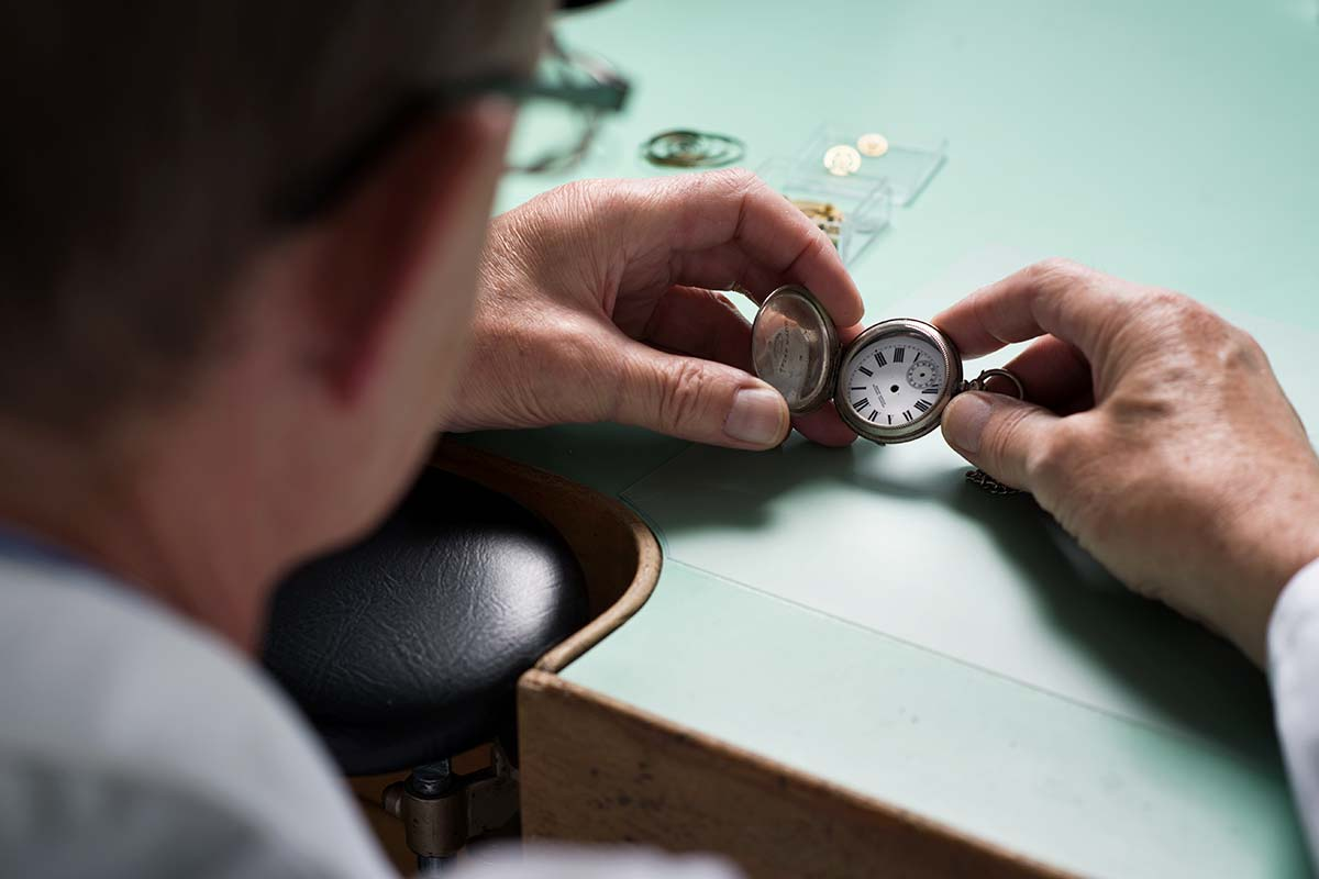 Watchmaker Holding a Pocket Watch